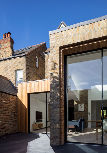 Exterior architecture is clad in brick and timber, 04 of 12.