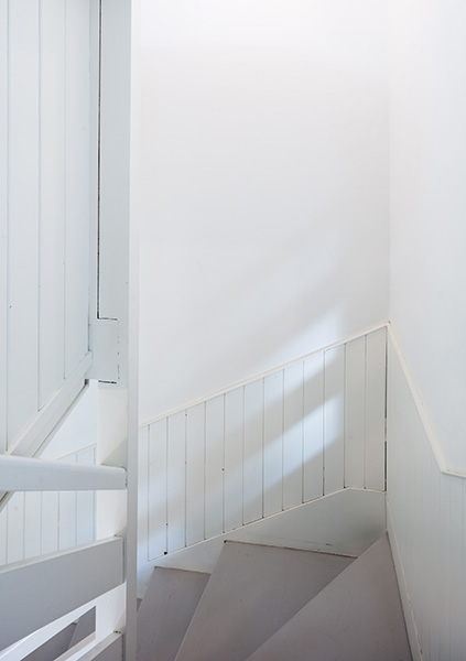 Interior stair view with painted boards and treads, 04 of 06.