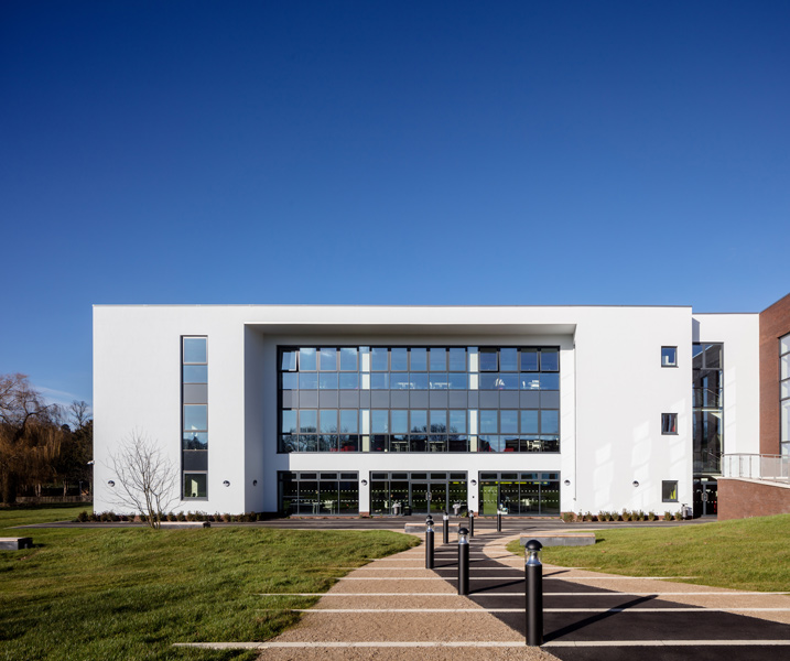 The new facade features white render and extensive glazing, 04 of 07.