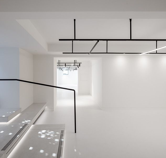 Office entrance features white walls and floor, 04 of 17.