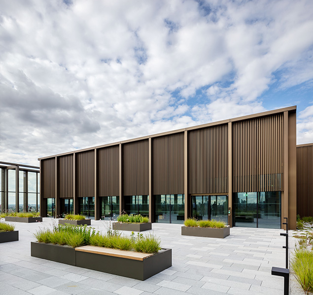Roof-top pavilion features bronze cladding, 04 of 04.