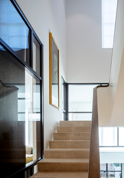 Staircase with stone treads and timber handrail, 04 of 11.