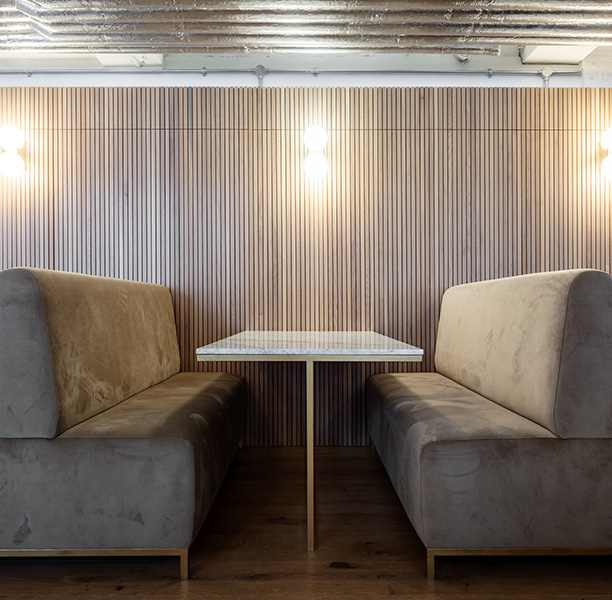 Banquette seating features custom furniture and beautiful timber wall cladding, 05 of 12.