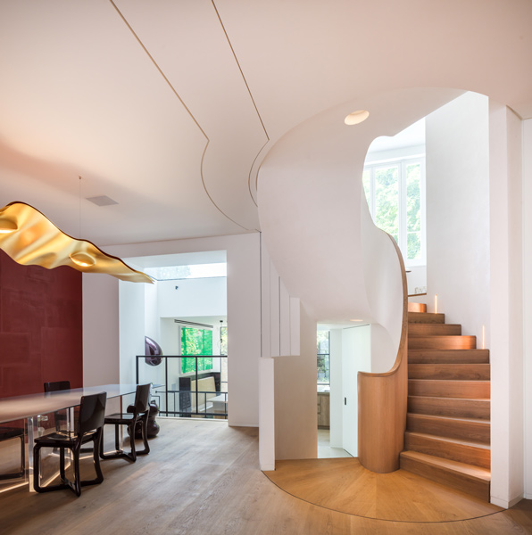 Photograph showing the dining areas and the sculptural staircase, 05 of 27.