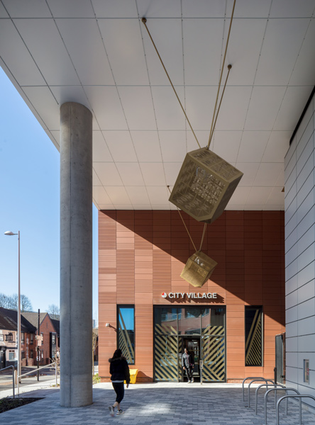 Entrance sequence photo showing public art and terracotta cladding, 06 of 08.