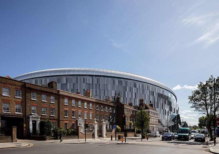 Exterior photograph showing the low impact of the stadium on the street to the North, 06 of 07.