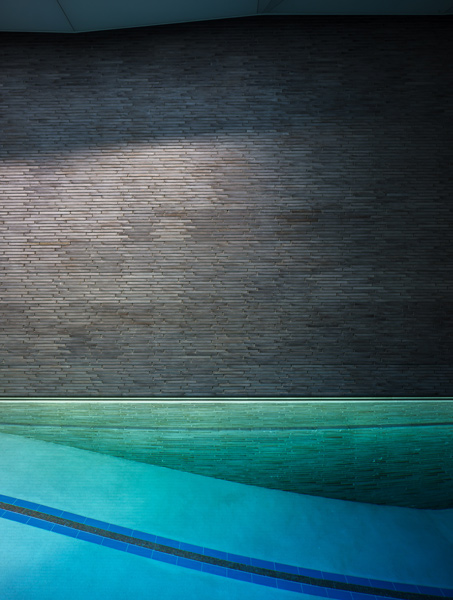 Subterranean pool featuring horizontal stonework and custom lighting design, 06 of 14.