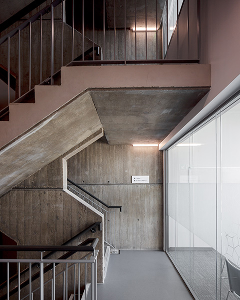 1960s in-situ poured concrete stairs are complemented by minimalist glass partitions warm colours, 07 of 11.