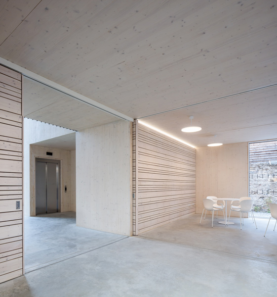 Interior features  poured concrete floors and large sliding timber doors, 07 of 16.