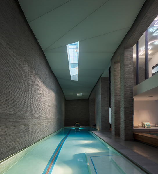 Photogrpah of the swimming pool which features an opalescent soffit with different lighting modes, 07 of 14.