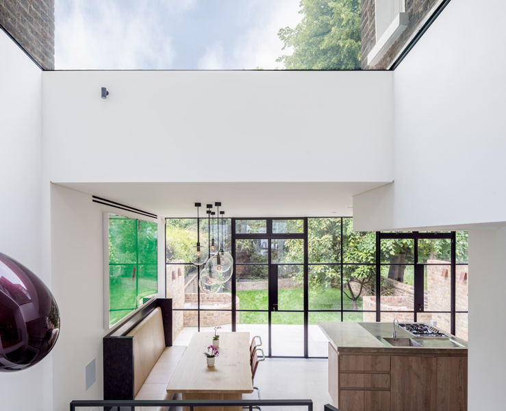 View of the kitchen from the atrium showing the rooflight, 07 of 28.