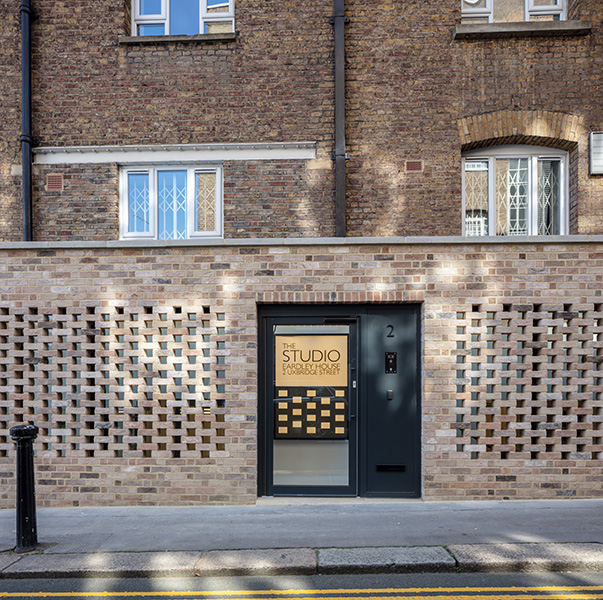 Exterior photograph of elevation with perforated brick screen, 09 of 17.