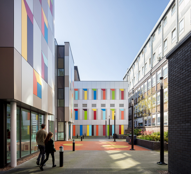 Exterior photograph of the private courtyard featuring coloured metal panels, 09 of 17.