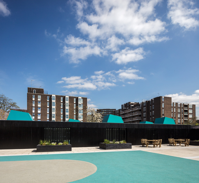 Photograph showing the playground and the black painted facade, 09 of 10.