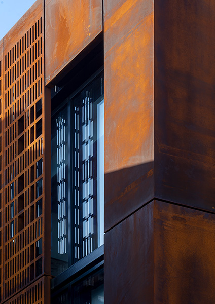 Exterior shot of the Cor-ten cladding and perforated facade, 10 of 10.