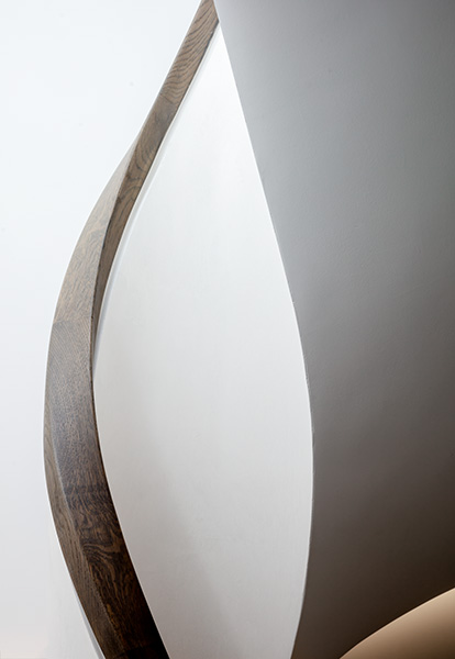 Detail photo showing the oak handrail and sculptural staircase, 11 of 11.