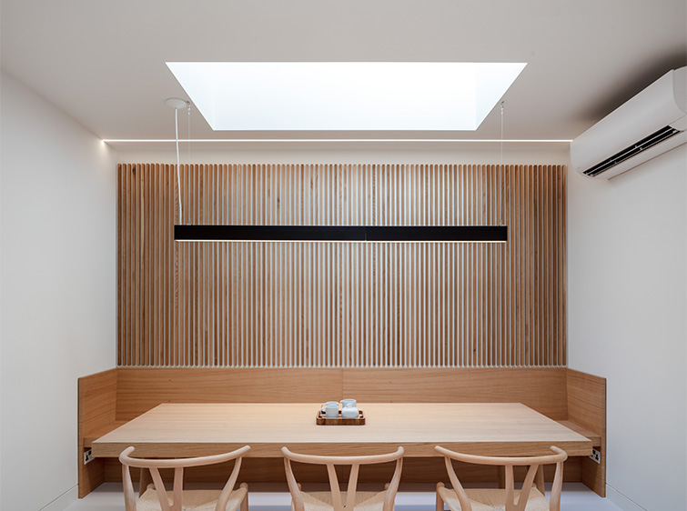 Dining and meeting area with timber panelling and classic modernist furniture, 11 of 17.