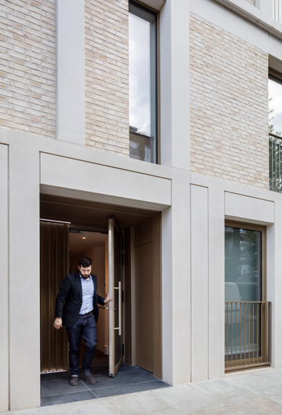 The front door features metal panels and controlled lighting, 11 of 15.