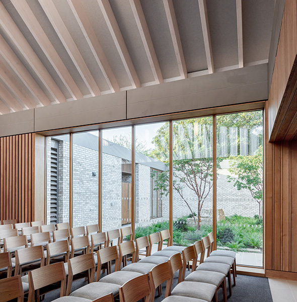 Chapel features extensive glazing creating connections to the private courtyards, 12 of 21.