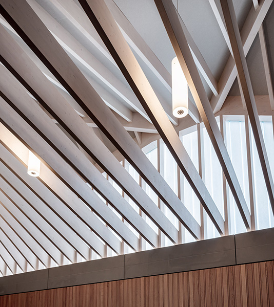 Chapel roof structure is beautifully designed in load-bearing timber, 13 of 21.