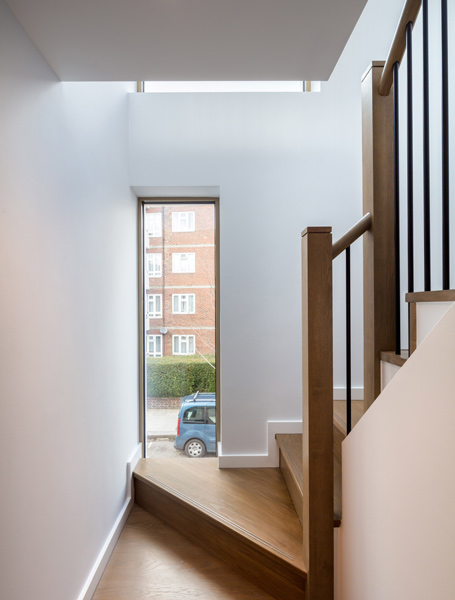 Interior shot showing how the timber stairs frame views, 13 of 15.