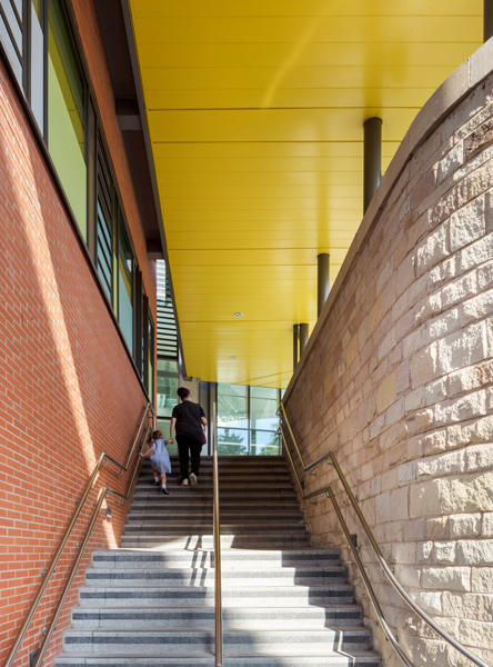 Stone and brick stair featuring a cheerful yellow soffit, 14 of 17.