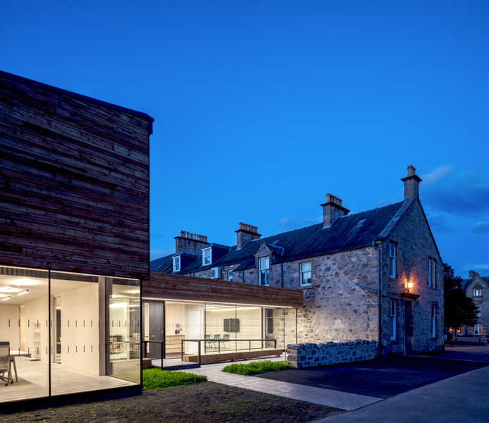 Dusk shot of the existing building and new extension, 15 of 16.
