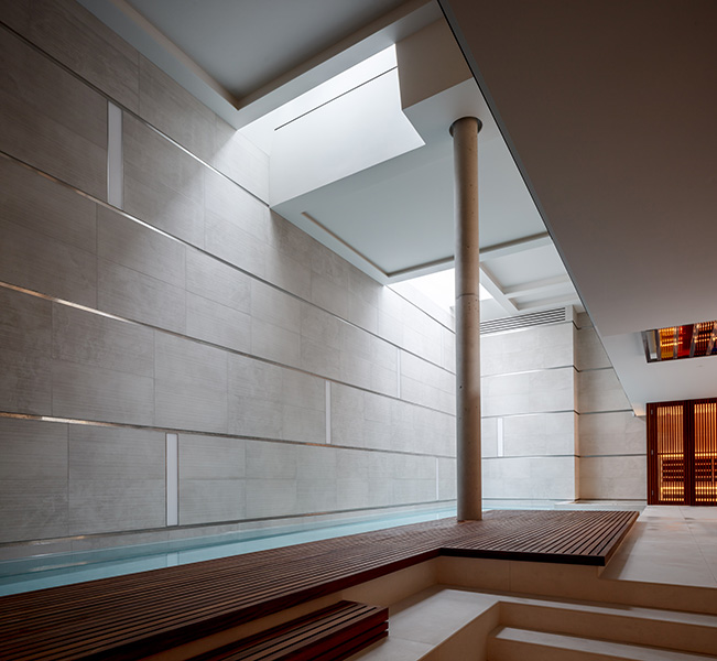 Interior pool photograph with teak and stone, 15 of 20.