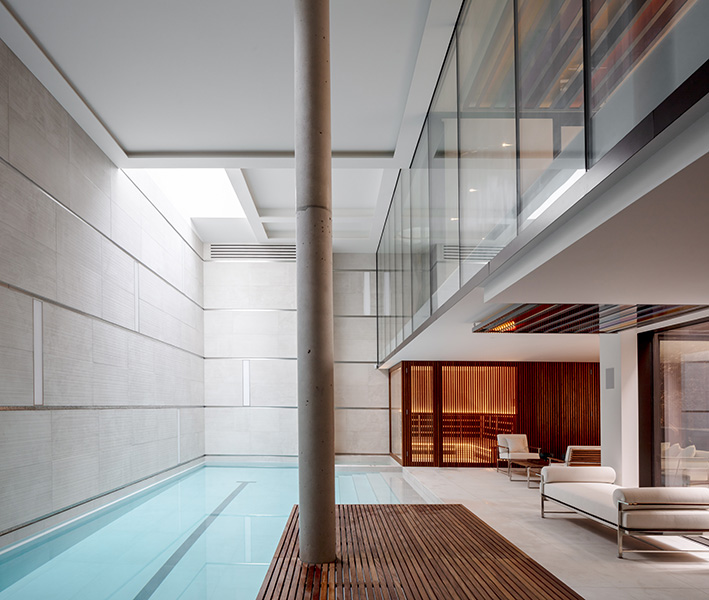 Interior shot of pool with teak floor and spa, 17 of 20.