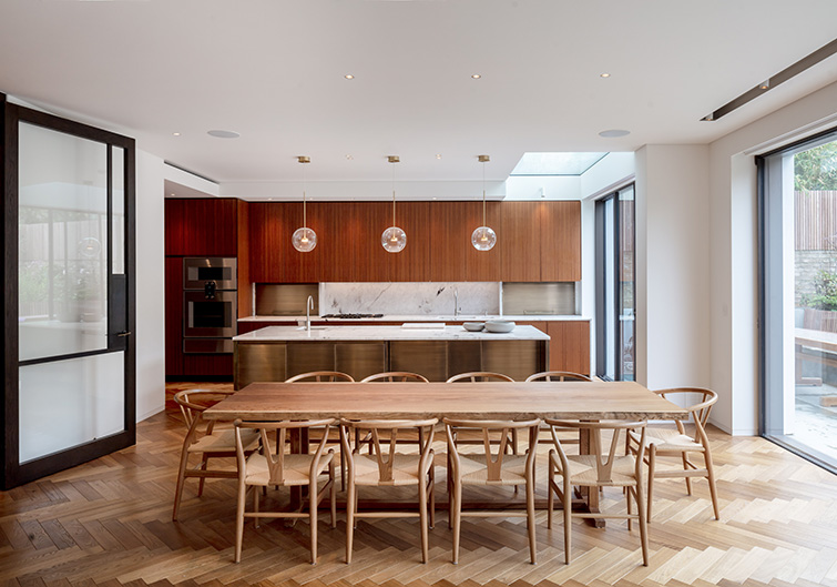 The stunning kitchen features bronze and veneer doors and classic modernist furniture, 20 of 20.