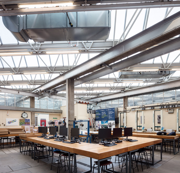 Workstations are located beneath the opalescent glass roof, 21 of 21.