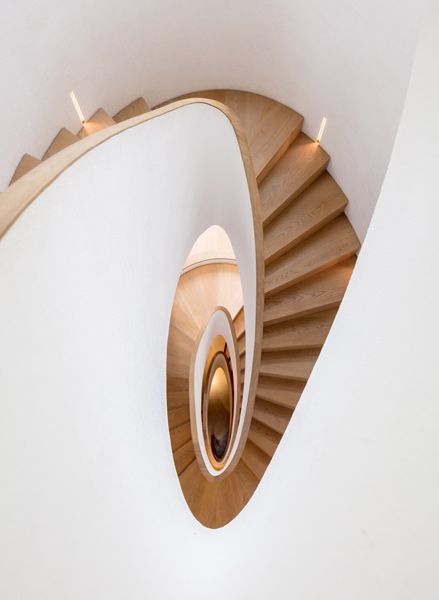 View looking down the sculptural staircase, 24 of 27.