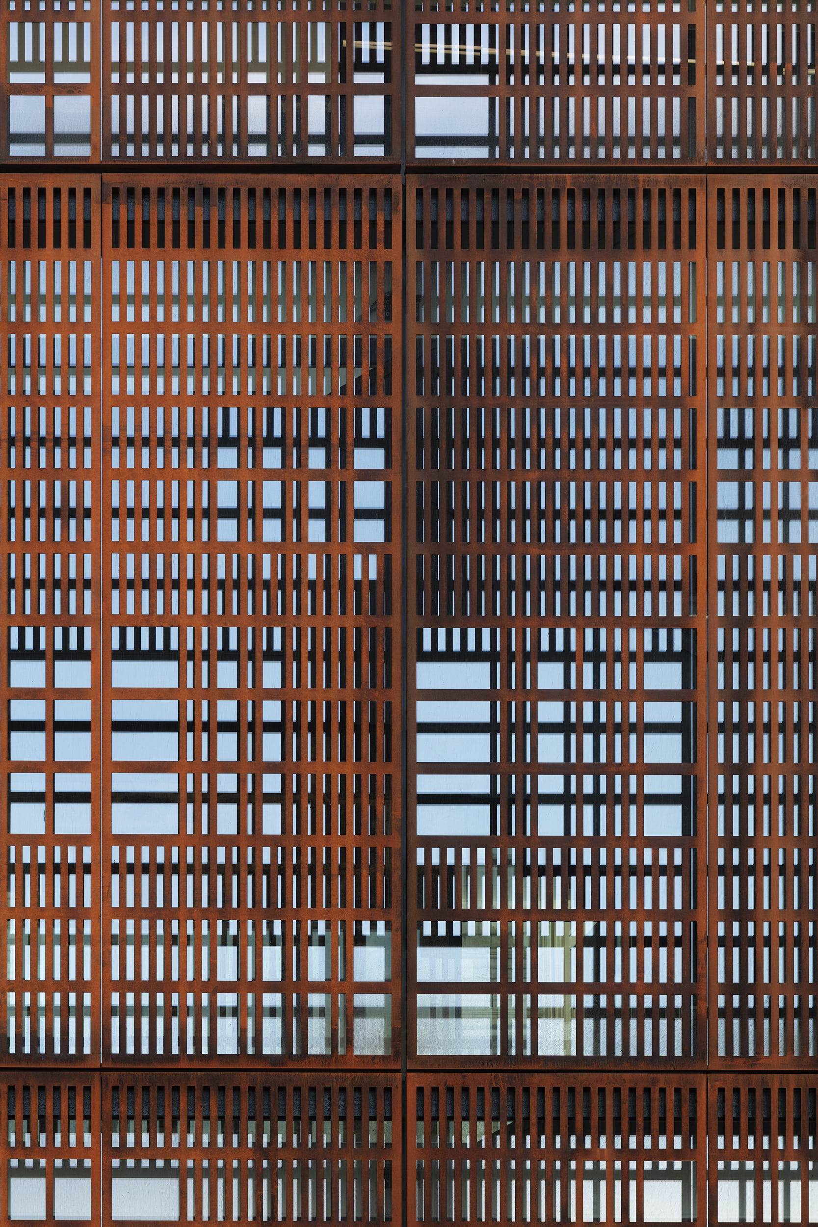 Architectural detail photograph showing perforated cor-ten steel screen.