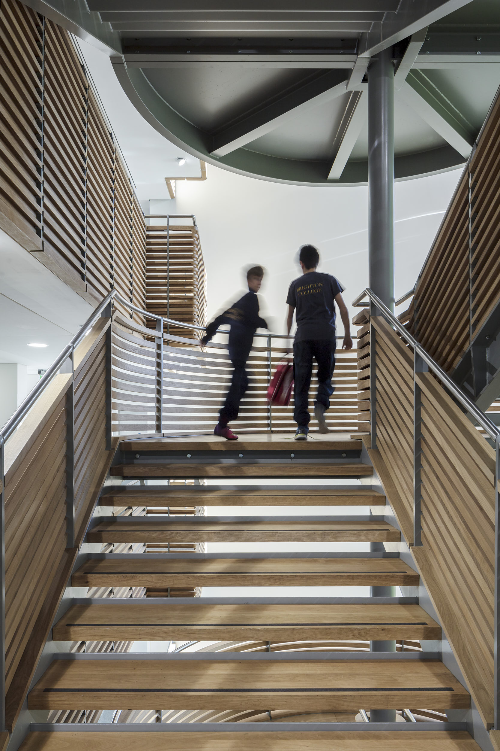 The interior staircase is a strong feature of the design.