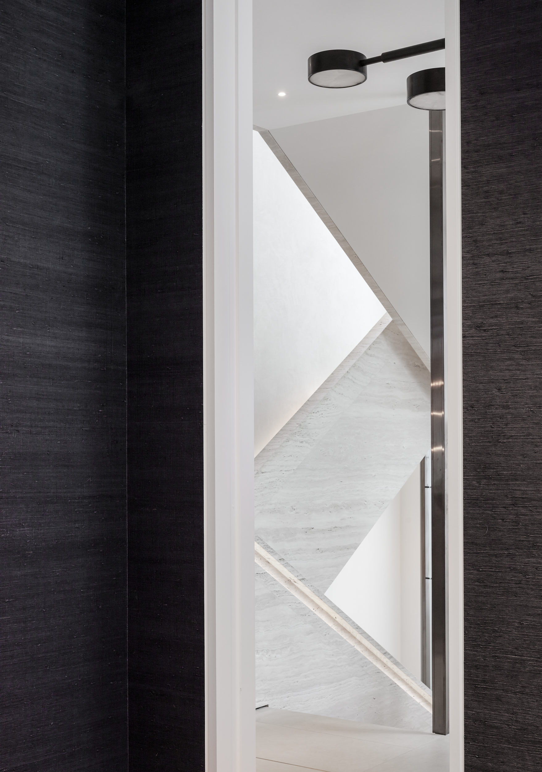 The design features timber panelling and exquisitely detailed marble.