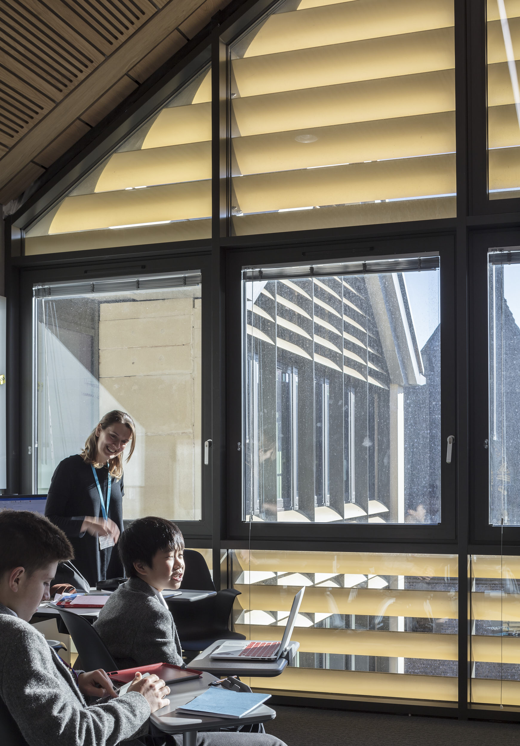 Classrooms feature external shading louvres and large areas of glazing creating a bright and airy atmosphere.