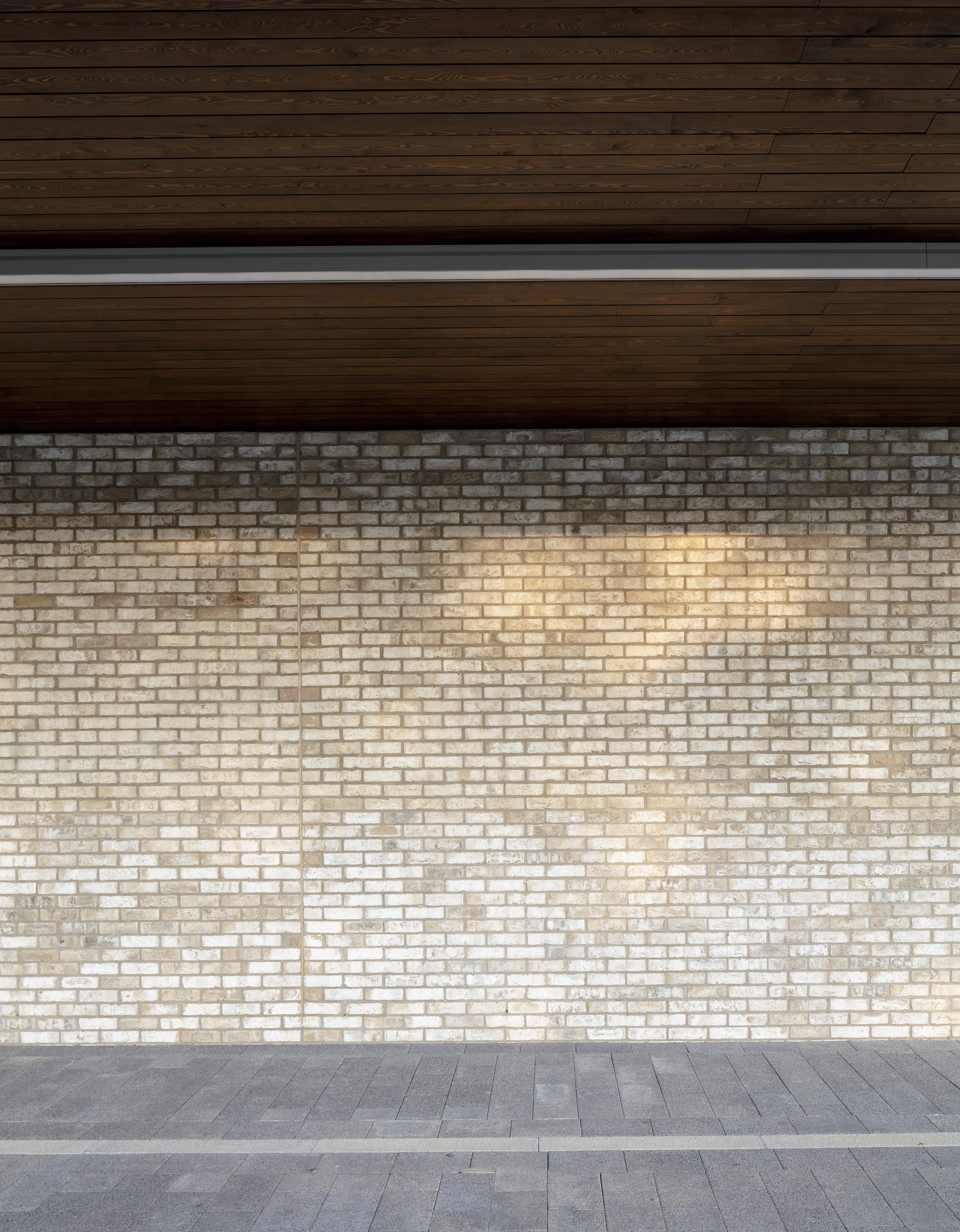 Detail photograph showing beautifully controlled materials and light fittings.