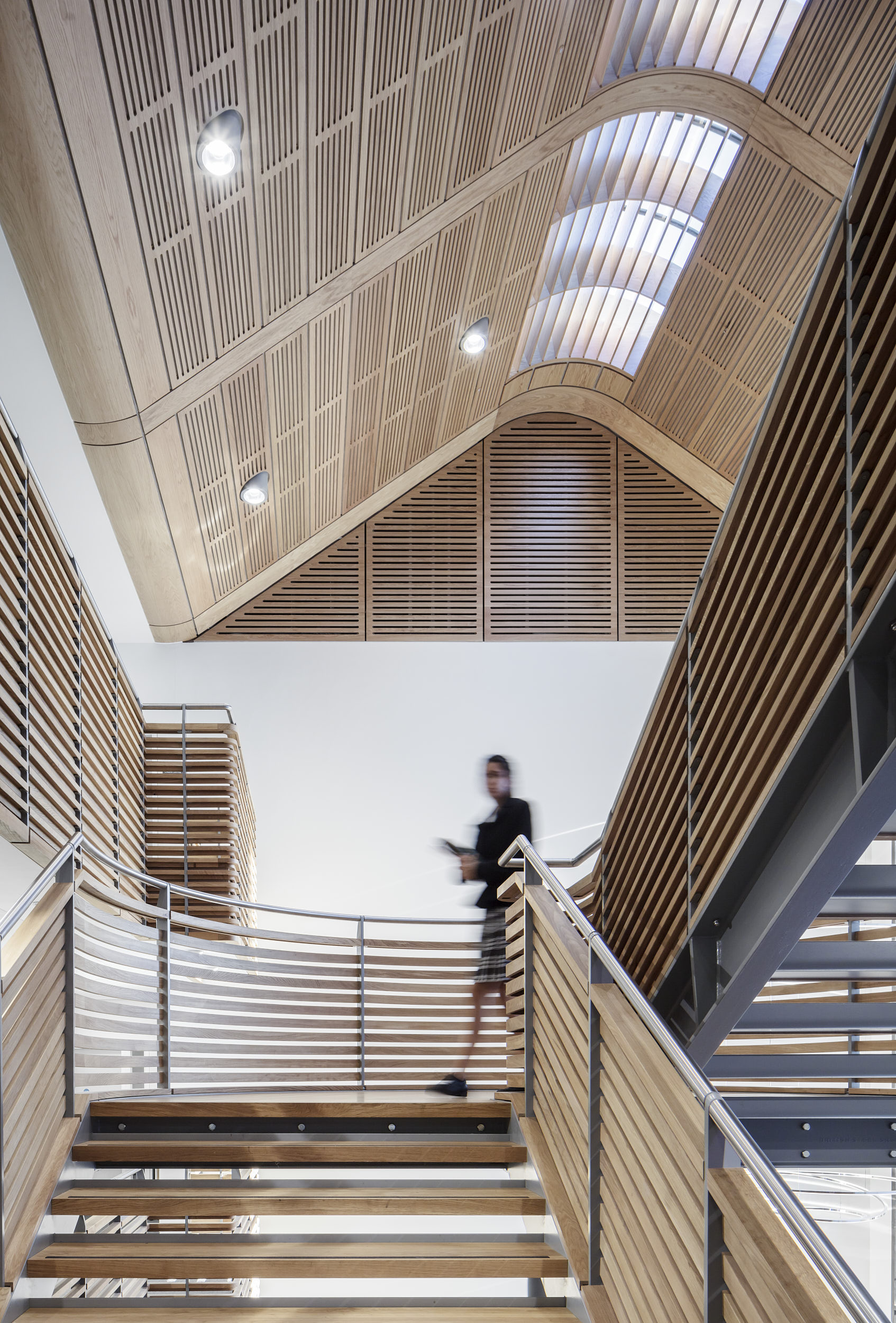 Interior photograph showing the timber and steel balustrade.