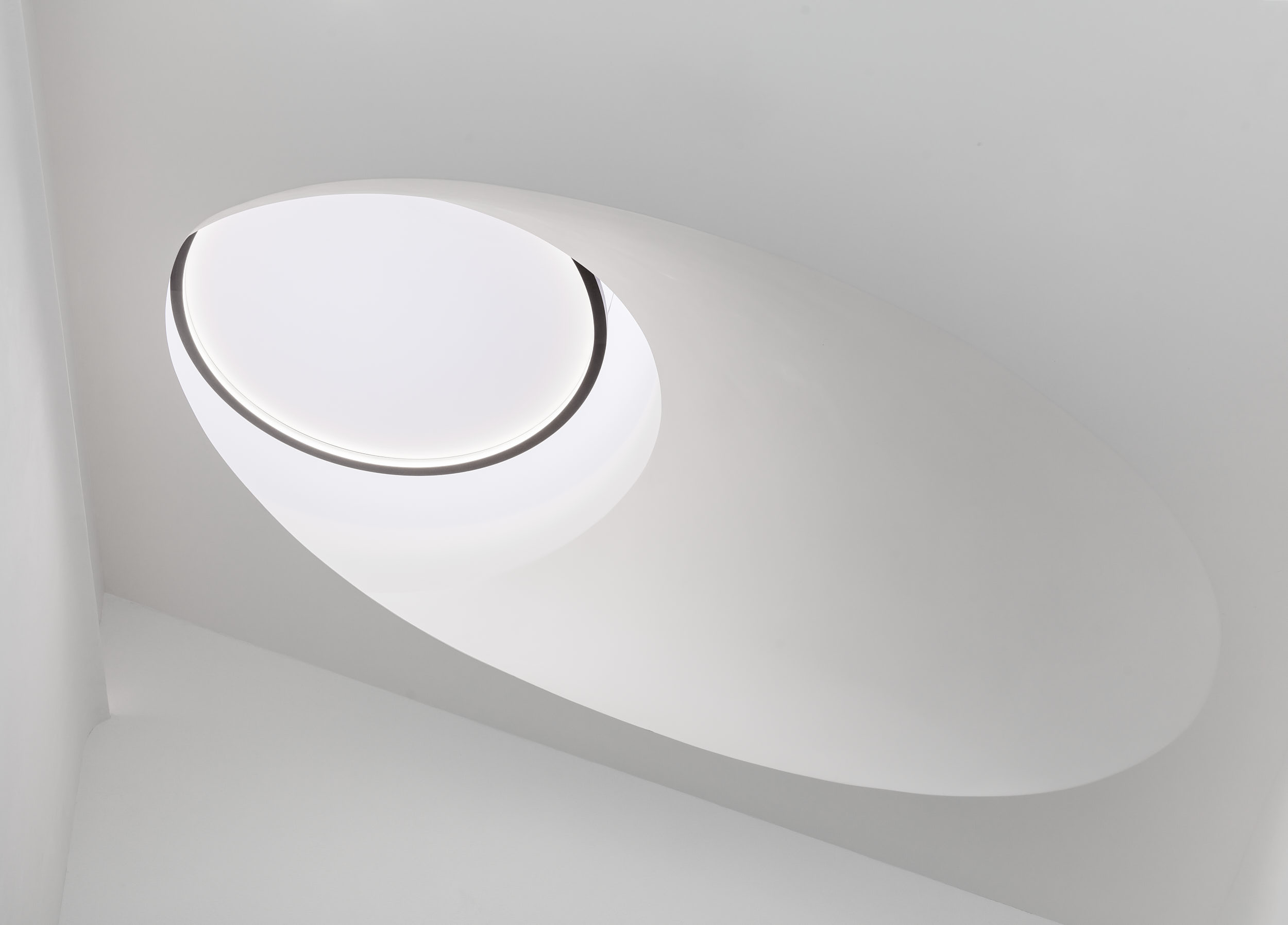 Sculptural rooflight brings more light to the staircase.