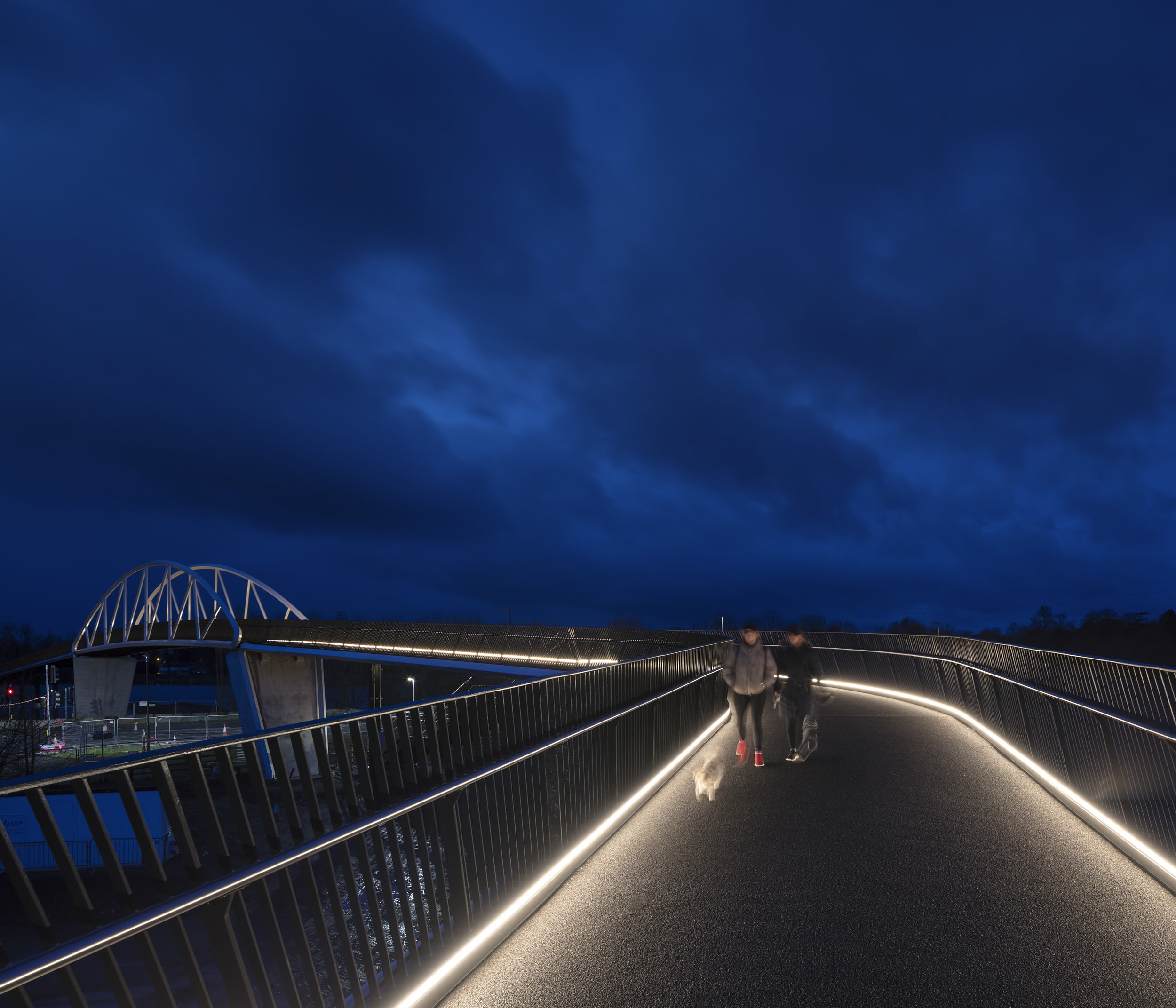 The design of the bridge references the visual language other local structures.