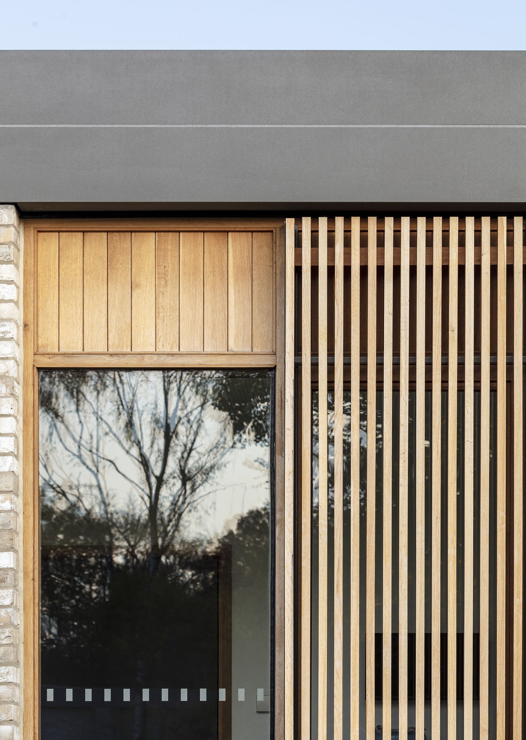 Exterior architectural detail photograph showing timber louvres and facade details.