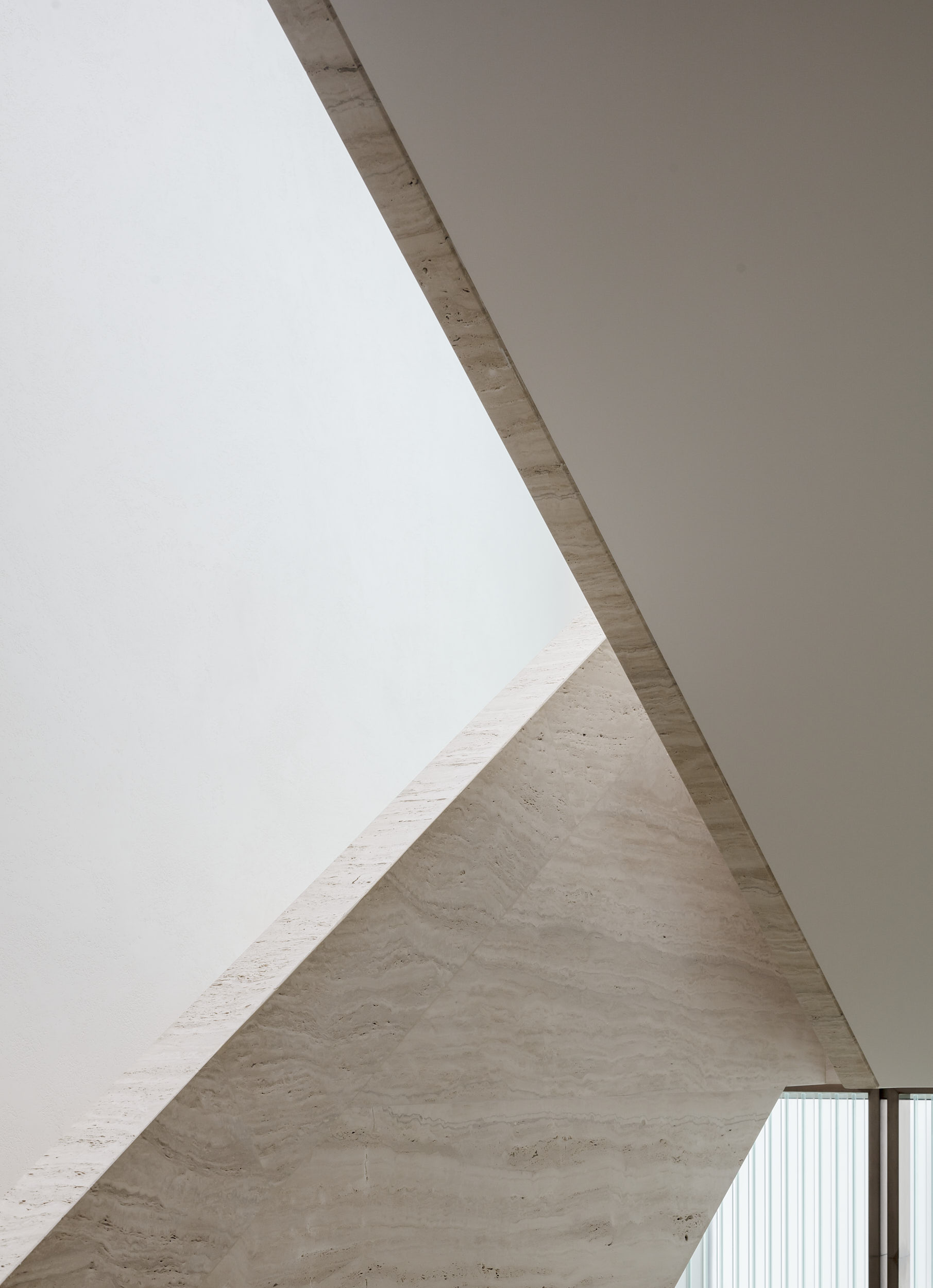 Interior photograph showing the minimalist architecture of the stair.