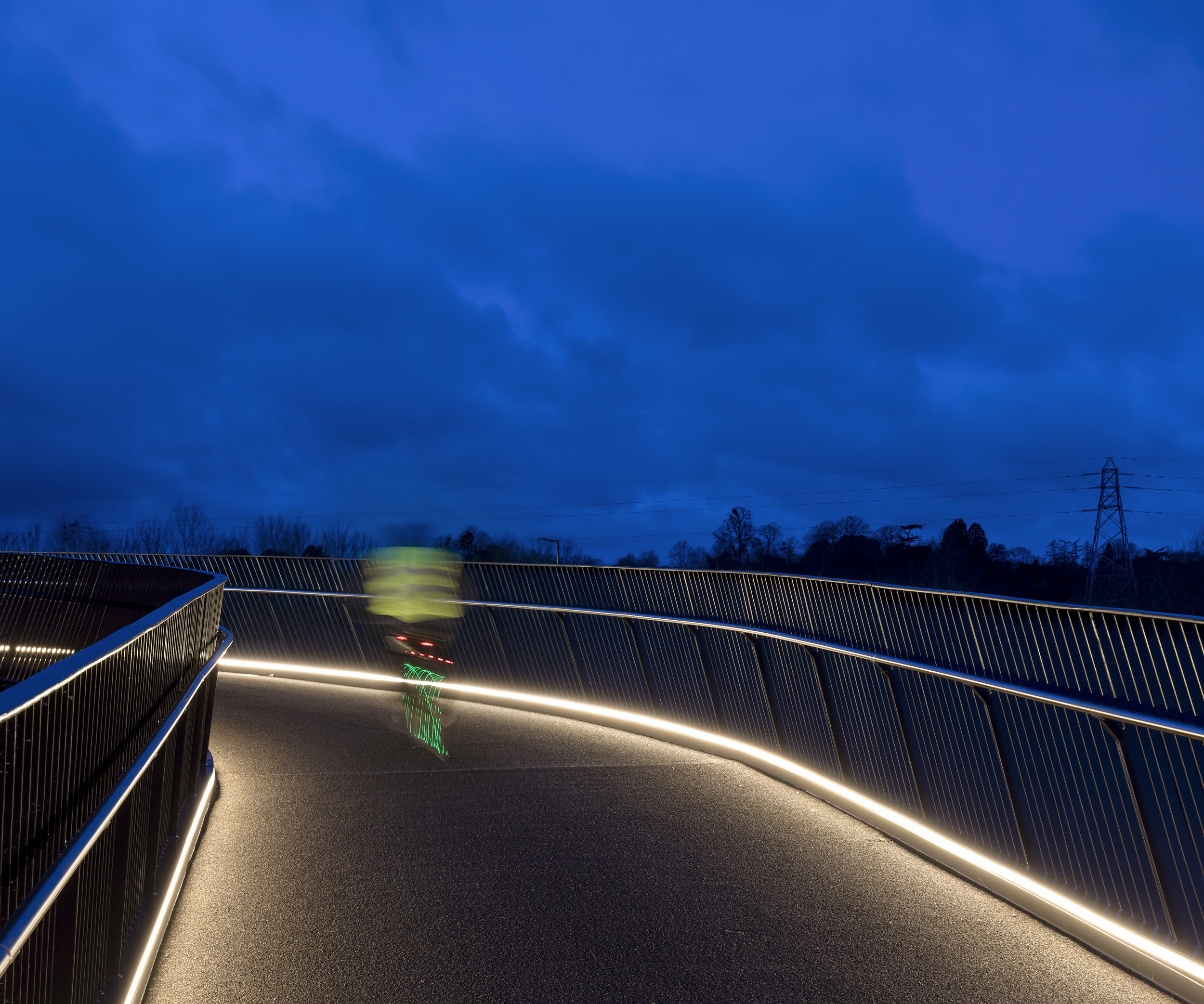 Night photography of a cyclist using the new bridge.