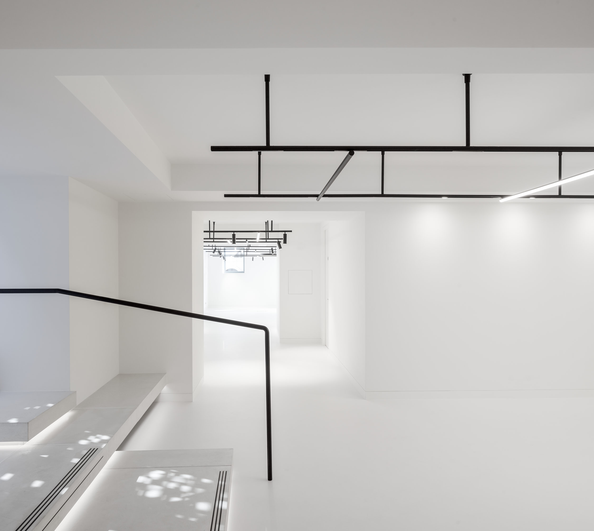 Office entrance features stunning white walls and floor.