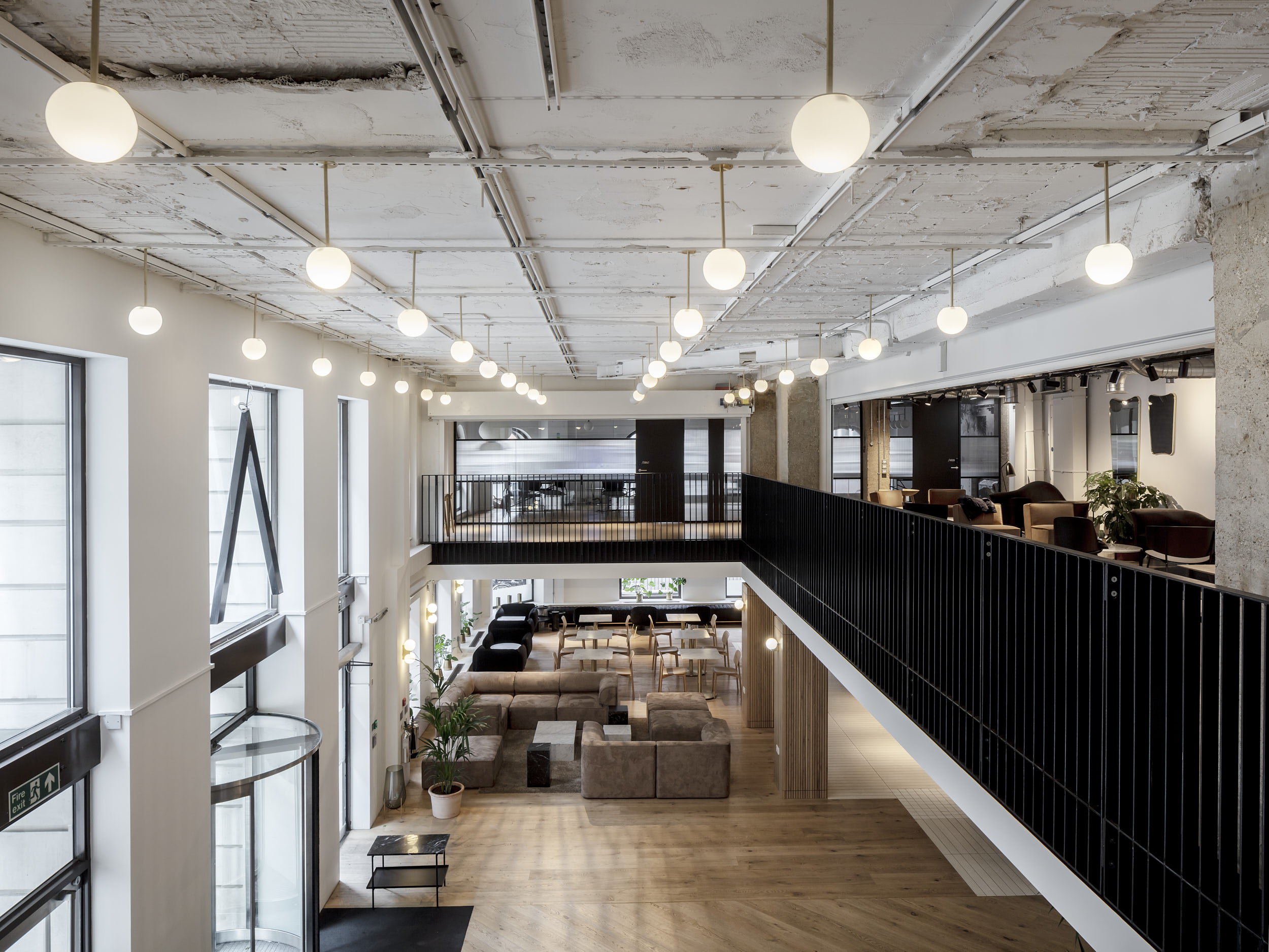 Architectural photography showing the double-height space of the reception from the gallery.