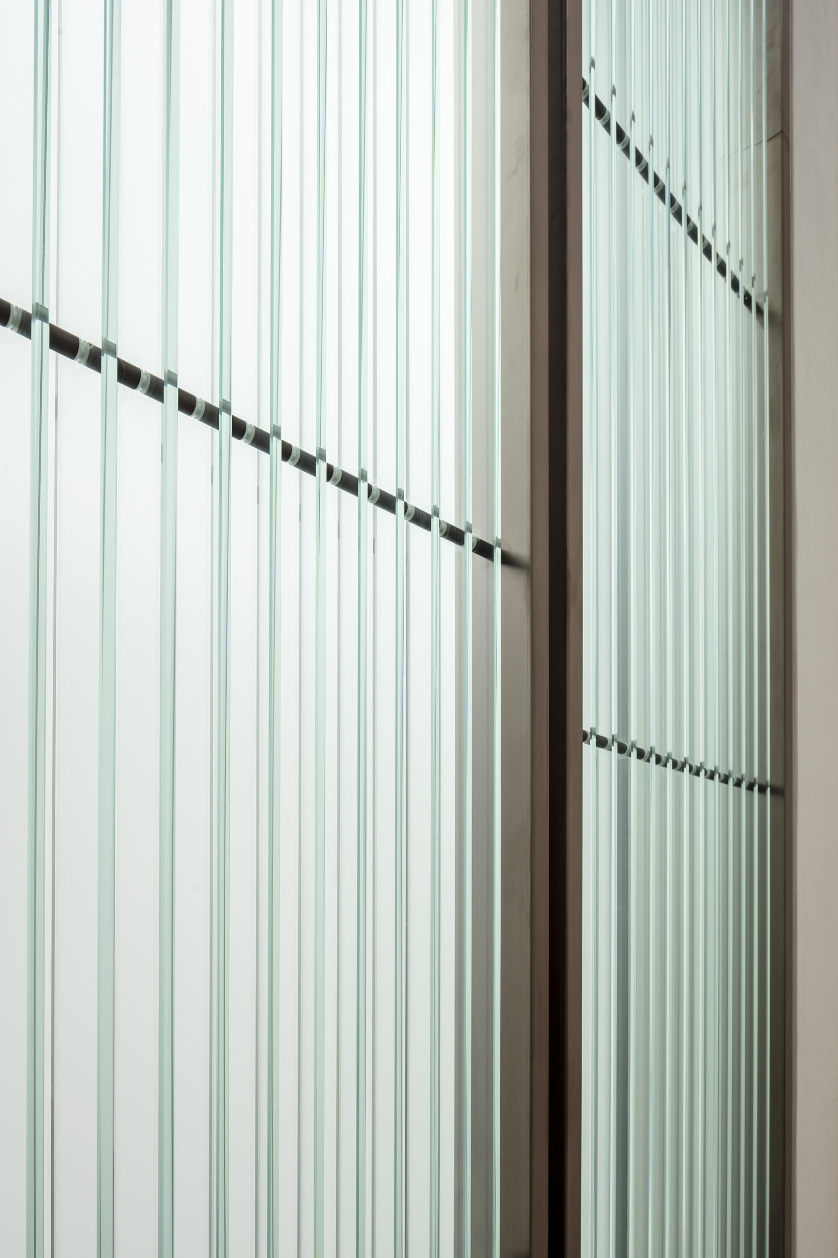 Glass fins and frosted glazing bringing light into the stair.