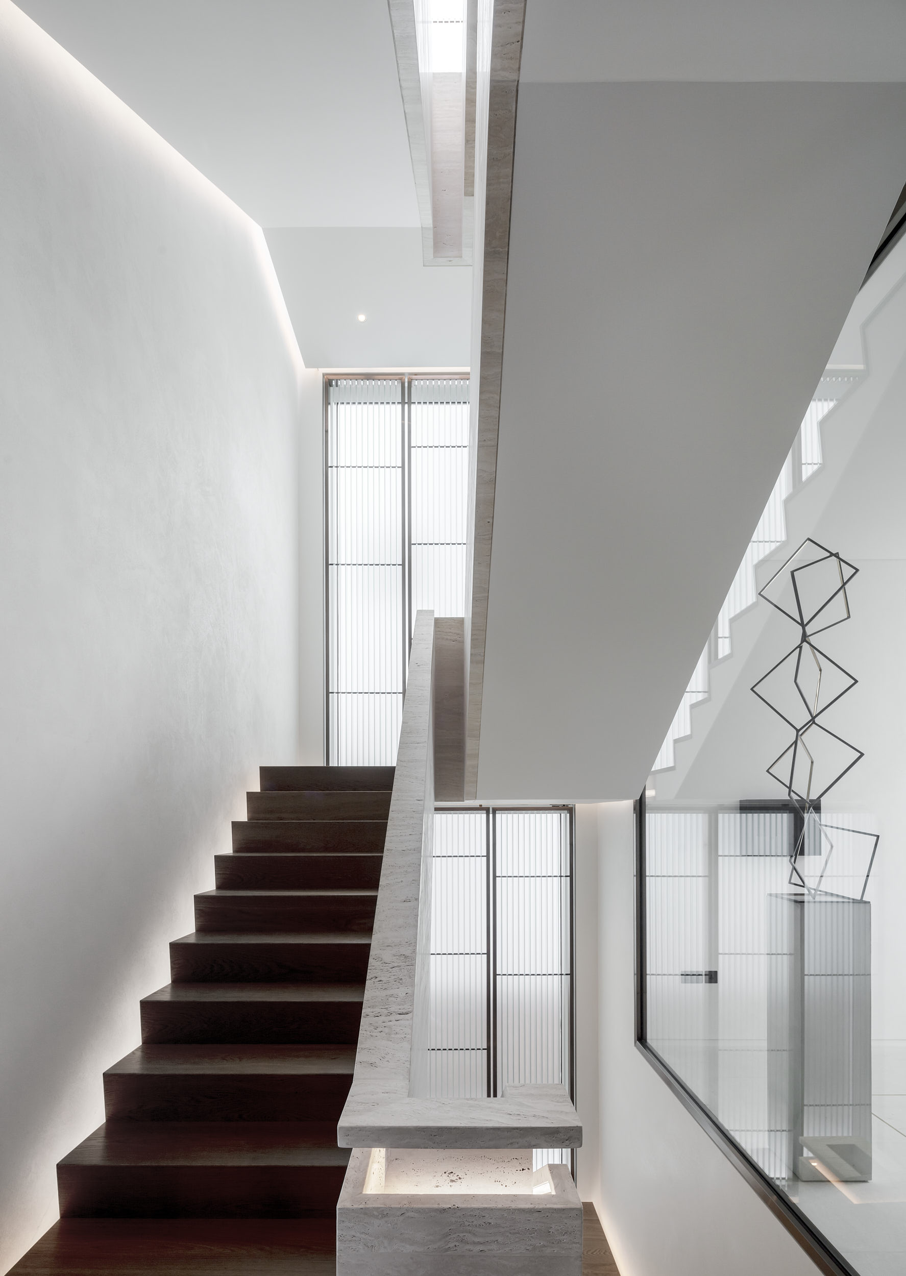 Architectural photography of the interior staircase.