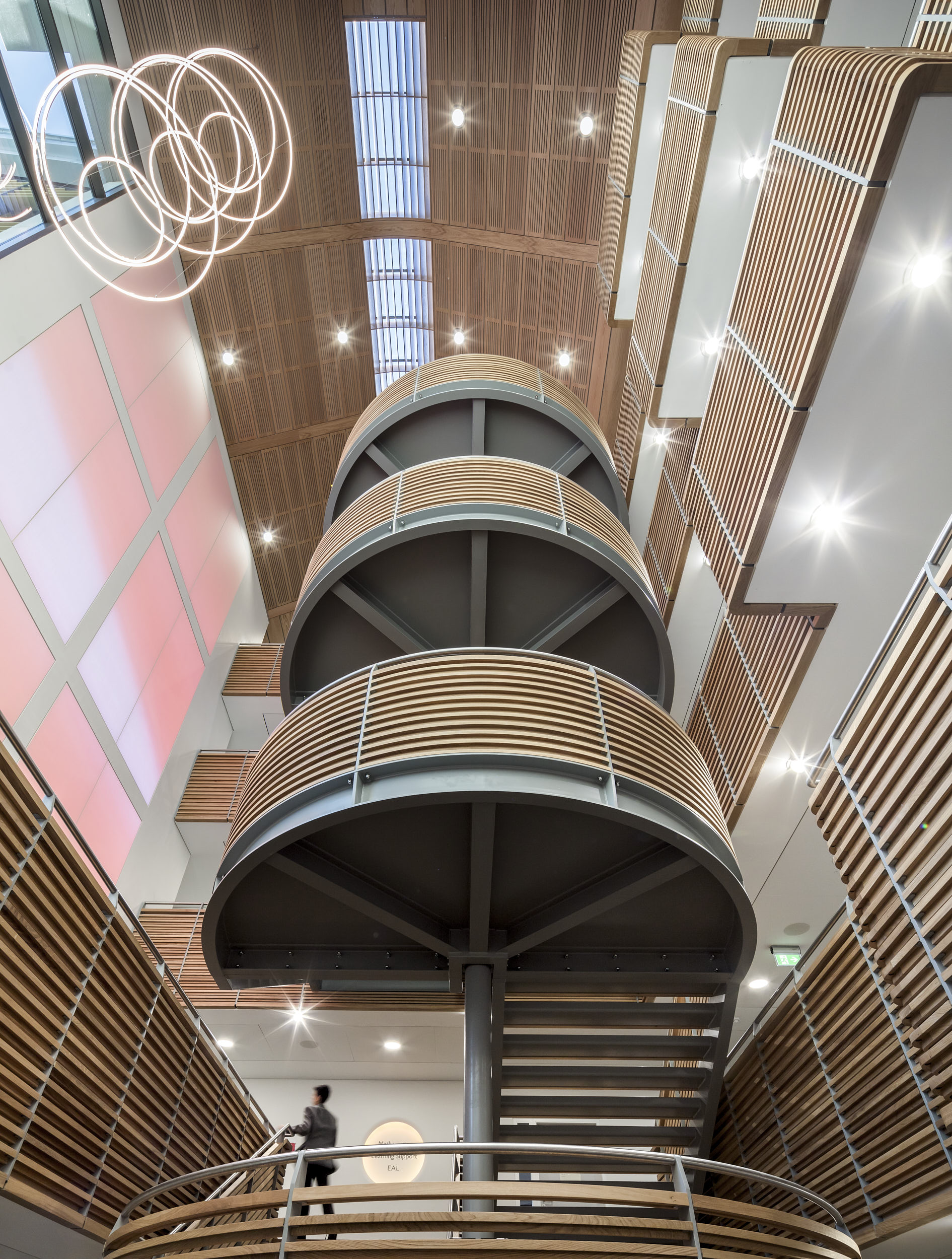 Looking up the atrium at the stair and roof-lights with the stunning timber soffit.