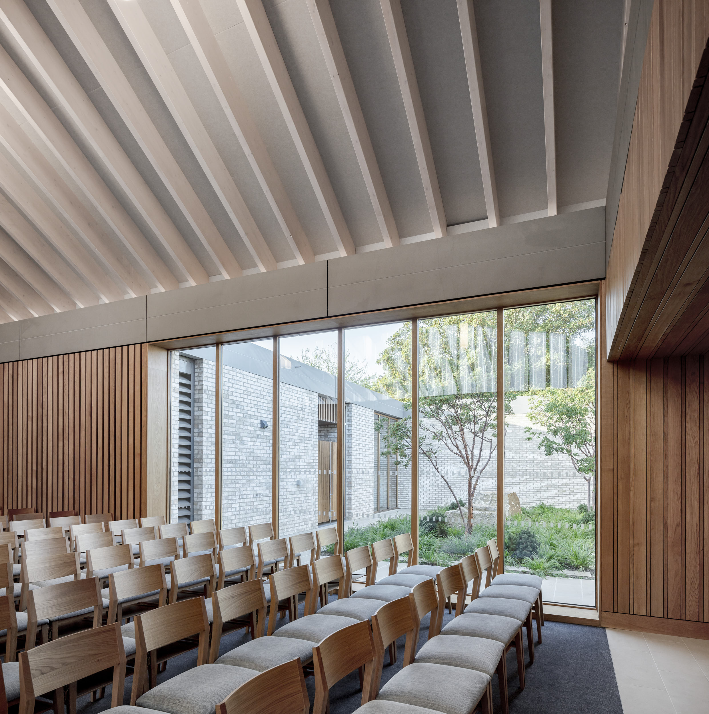 The new chapel features extensive glazing creating intimate connections to the private courtyards.