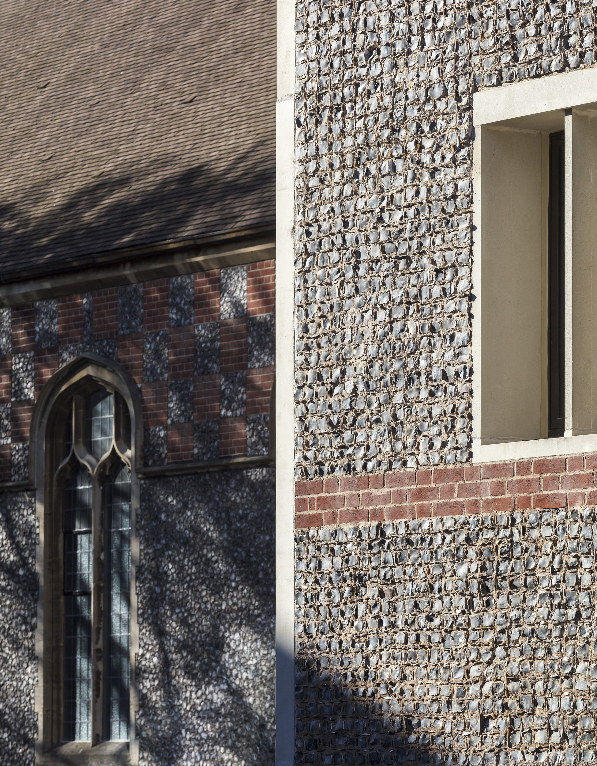 New exterior materials complement historical surfaces.